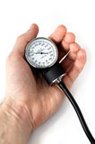 Manual blood pressure monitor in hand medical tool isolated Royalty Free Stock Photo