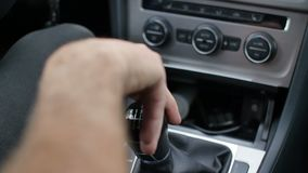 Manual car shift gear changed by hand in automobile interior.  stock video footage