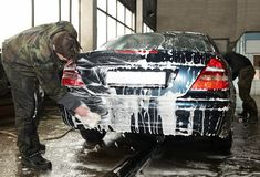Manual car washing Royalty Free Stock Photos