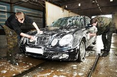 Manual car washing. Cleaning with foam and water at service station Stock Photo