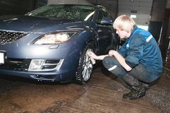 Manual car washing. Cleaning with foam and water at service station royalty free stock images