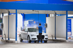 Manual car washing cleaning with foam and pressured water. At service station Stock Photography