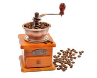 Manual coffee grinder and coffee beans. Isolated on a white background Royalty Free Stock Photo