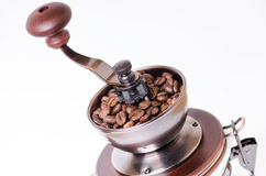 Manual coffee grinder with coffee beans. Isolated. White background. Modern style. Roasted coffee beans. Stock Images