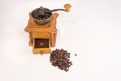 Manual coffee grinder and coffee beans Royalty Free Stock Image