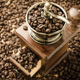 Manual coffee grinder with coffee beans Stock Photography