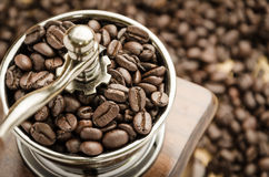Manual coffee grinder with coffee beans. Vintage manual coffee grinder with coffee beans royalty free stock images