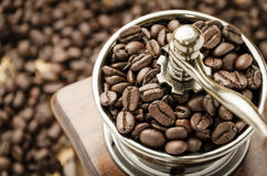 Manual coffee grinder with coffee beans. Vintage manual coffee grinder with coffee beans royalty free stock photos
