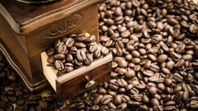 Manual coffee grinder with coffee beans. Vintage manual coffee grinder with coffee beans stock photos