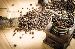 Manual coffee grinder with coffee beans. Vintage manual coffee grinder with coffee beans stock images