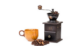 Manual coffee grinder and coffee cup,coffee bean Royalty Free Stock Images