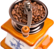 Manual coffee grinder with coffee grains Royalty Free Stock Photography