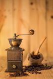 Manual coffee grinder and  cup of coffee Stock Photography