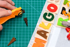 Manual cutting letters with colored sheets of felt Royalty Free Stock Images