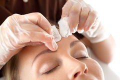 Manual facial cleansing. Cleansing facial skin, beautician squeezed blackheads royalty free stock photography