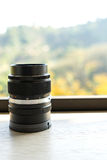 Manual focus camera lens with blurred mountain background Stock Photo
