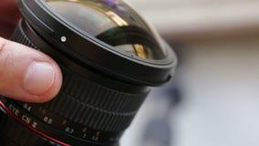Manual focus of the camera lens. Closeup. stock footage