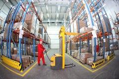 warehousing - manual forklift operator at work in stock photo