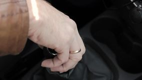 Manual gear shift knob on a vehicle. hand of driver, driving car shifting gears stock video footage
