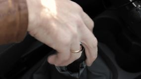 Manual gear shift knob on a vehicle. hand of driver, driving car shifting gears stock video