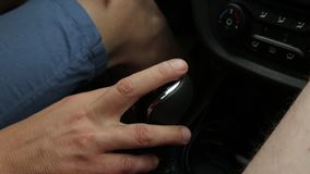 Manual gear shift knob on a vehicle. hand of driver, driving car shifting gears.  stock video footage