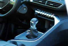 Manual gear shift. Mauelnog shift lever in the passenger car royalty free stock image