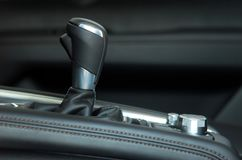 Manual gear shift. Mauelnog shift lever in the passenger car royalty free stock images