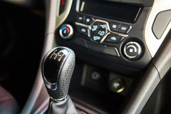 Manual gearbox in the car. 6 speed gear stick closeup. Manual gearbox in the car Royalty Free Stock Photo