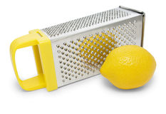 Manual grater with yellow handle and lemon Royalty Free Stock Images