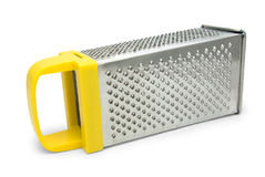 Manual grater with yellow handle Royalty Free Stock Image