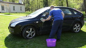 Manual hand car wash cleaning with foam and sponge on open air. stock video footage