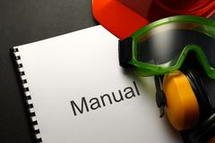 Manual with helmet. Goggles and headphones royalty free stock photography