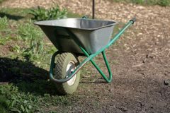 Manual household cart. Iron trolley for manual moving of building materials in the garden and in the backyard royalty free stock image