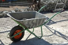 Manual household cart. Iron trolley for manual moving of building materials in the garden and in the backyard stock image
