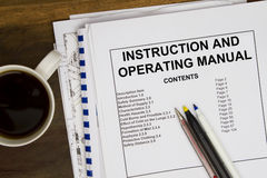 Manual. Instruction and operating manual with coffee Royalty Free Stock Photography