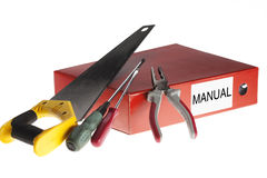 Manual instructions with working tools on white background.  Royalty Free Stock Images