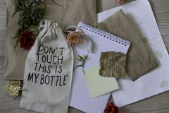 Manual layout with flowers, paper and a small bag stock images