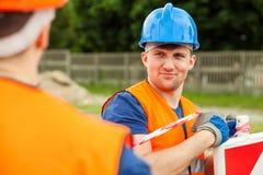 Manual lobourer wearing safety helmet Stock Image