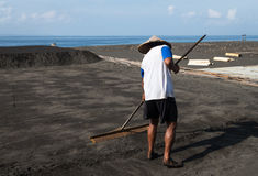 Traditional sea salt production on on the volcanic black sand, B Stock Images