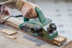 Manual manufacturing of furniture from a natural tree in a workshop. stock photos