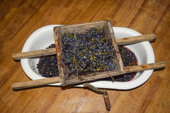 Manual mechanism for crushing grapes. Crush the grapes into juice and wine.  royalty free stock image