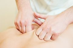 Manual medical massage technique. Manual medical relaxation procedure massage of human back against physical strain stock photography