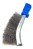 Manual metal brush with the blue handle on a white background Stock Photo
