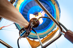 Manual operation of the gas burner balloon Stock Image