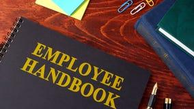 Manual ou manual de empregado foto de stock