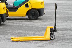 Manual pallet jack. Yellow manual pallet jack  truck for transport Stock Photos