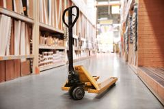 Manual pallet jack. In supermarket royalty free stock photo
