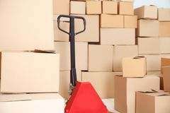 Manual pallet truck with boxes. Manual pallet truck with carton boxes Stock Photo