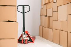 Manual pallet truck with boxes. Manual pallet truck with carton boxes Stock Image
