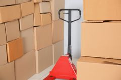 Manual pallet truck with boxes. Manual pallet truck with carton boxes Royalty Free Stock Photography